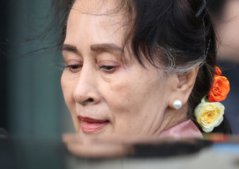 Myanmar's leader Aung San Suu Kyi leaves after attending a hearing at International Court of Justice in The Hague