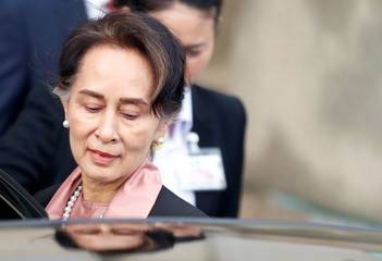 Myanmar's leader Aung San Suu Kyi leaves the International Court of Justice in The Hague