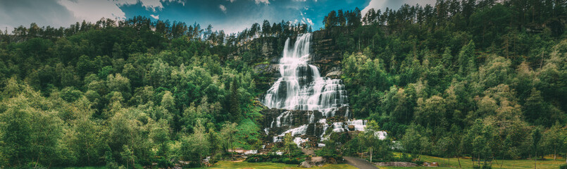 Voss, Hordaland, Norway. Waterfall Tvindefossen In Spring. Largest And Highest Waterfall Of Norway. Famous Natural Norwegian Landmark And Popular Destination. Panorama, Panoramic View