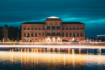 Stockholm, Sweden. National Museum Of Fine Arts Is The National Gallery Of Sweden, Located On The Peninsula Blasieholmen. Touristic Pleasure Boats Floating Near Nationalmuseum In Summer Evening Night