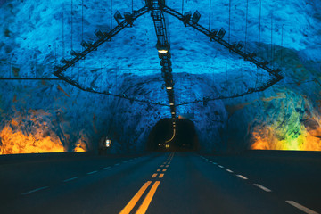 Laerdal Tunnel, Norway. Road On Illuminated Tunnel In Norwegian Mountains. Famous Longest Road Tunnel In World. Popular Place