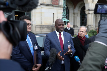 Gambia's Justice Minister Abubacarr Tambadou talks to the media after a hearing at International Court of Justice in The Hague