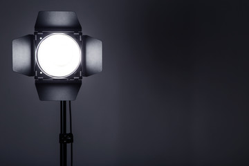 Fotobehang Licht, schaduw Studio lighting with tripod on black background