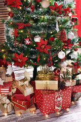 lots of presents under Christmas tree