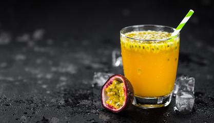 Some fresh made  Maracuja Juice on a vintage slate slab (selective focus)