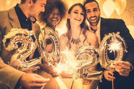 Men and women celebrating the new year 2020