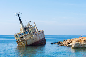 Fotobehang Schipbreuk Abandoned ship that was shipwrecked off near the coast of Cyprus