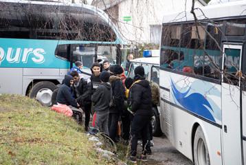 Migrants are seen near migrant camp in Vucjak