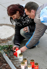 People light candles outside the University Hospital in Ostrava