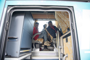 Migrants are seen a in bus near migrant camp in Vucjak