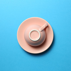Pink coffee cup on blue background