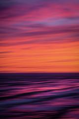Fototapeten Hochrote Blurry Sunset