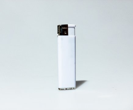 Isolated shot of a white lighter on white background