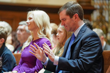 Kentucky's Democratic Governor Beshear prays during church service prior to his inaugural parade and swearing-in ceremony in Frankfort