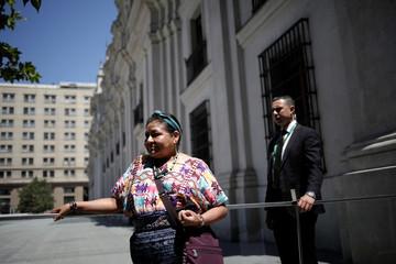 Nobel Peace Prize laureate Rigoberta Menchu awaits to enter at Palacio de la Moneda in Santiago