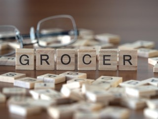 grocer the word or concept represented by wooden letter tiles