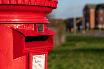 Tuinposter Londen rode bus A classic vintage red mailbox for posting letters in a Street in Wales, United Kingdom
