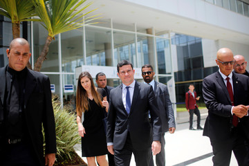Brazil's Justice Minister Sergio Moro walks after a seminary in Brasilia