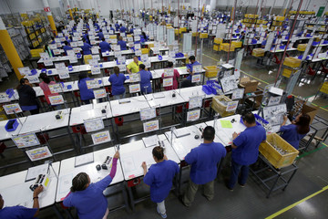 Employees work at Ark de Mexico, an assembly factory that makes wire harnesses and electric components for the automobile industry, in Ciudad Juarez