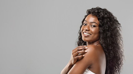 Fototapete - Black Woman With Natural Makeup and White Teeth On Grey Background