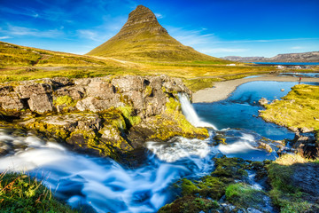 Iceland Landscape Summer Panorama, Kirkjufell Mountain during a Sunny Day with Waterfall in Beautiful Light Wall mural