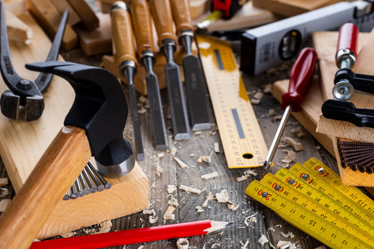 Close-up of carpenter's tools on an antique wooden table. Construction industry, do it yourself. Wooden work table.