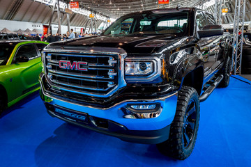 "STUTTGART, GERMANY - MARCH 03, 2017: Heavy-Duty pickup truck GMC Sierra 1500 Crew Cab SLT, 2017. Europe's greatest classic car exhibition ""RETRO CLASSICS"""