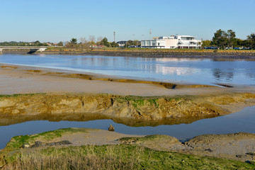 Sea at low tide and building in the background at Saint-Gilles-Croix-de-Vie, commune in the Vendée department in the Pays de la Loire region in western France