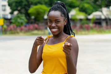 Happy african american woman with dreadlocks