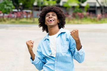 African american hipster young adult freaking out