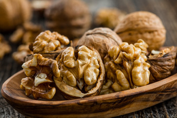 Handful of Walnuts on wooden background