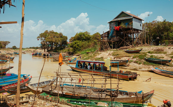 Floating Village Boats on the river in Cambodia near Pean Bang and Tonle Sap Lake