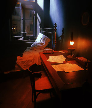 manuscripts under the light of the 19th Century Antique kerosene lamp, a mysterious ray of light through the window