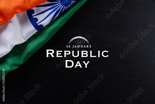 Indian republic day concept. Indian flag with the text Happy republic day against a blackboard background. 26 January.