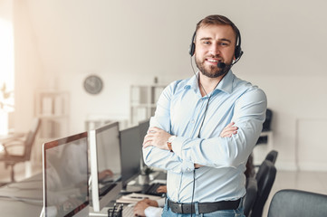 Fototapeta Portrait of male technical support agent in office obraz