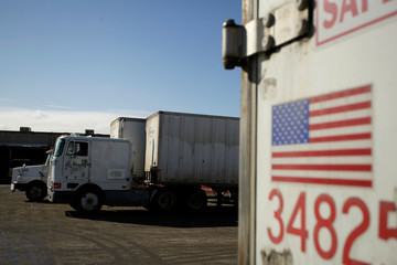 A U.S. flag is picture on a truck loaded with merchandise at the freight shipping company Sotelo, which transports goods between Mexico and the United States, in Ciudad Juarez