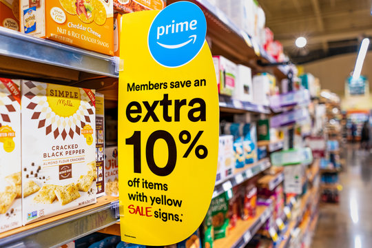 Nov 30, 2019 Santa Clara / CA / USA - Amazon Prime member offer details displayed in a Whole Foods store in San Francisco bay area