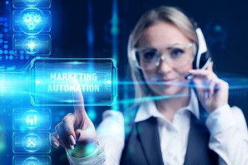 Business, Technology, Internet and network concept. Marketing content. Businessman presses a button Marketing automation  on the virtual screen tablet future.
