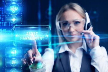 Business, Technology, Internet and network concept. Marketing content. Businessman presses a button Asset management on the virtual screen tablet future.
