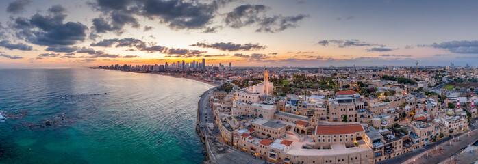 Aerial view of Tel Aviv Yafo along the Mediterranean sea at predawn with colorful sky over the city in Israel