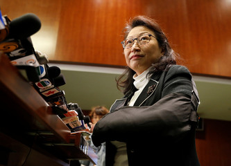 Hong Kong Secretary for Justice Teresa Cheng addresses the media after taking questions from lawmakers at the Legislative Council in Hong Kong