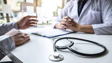 Doctor having conversation with patient while discussing explaining symptoms or counsel diagnosis health and consult treatment of disease, healthcare and assistance concept
