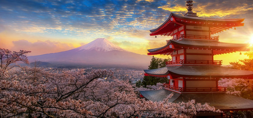 Spoed Fotobehang Tokio Fujiyoshida, Japan Beautiful view of mountain Fuji and Chureito pagoda at sunset, japan in the spring with cherry blossoms