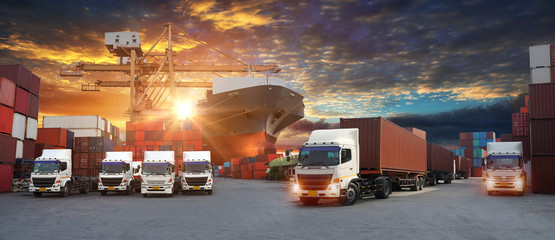 Wall Mural - Container truck in ship port for business Logistics and transportation of Container Cargo ship and Cargo plane with working crane bridge in shipyard at sunrise, logistic import export and transport in