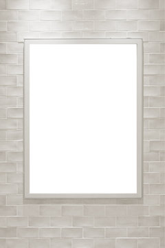 壁にかけたフレームに入れるポスターのモックアップ