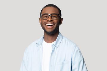 Joyful happy african american young man in eyeglasses portrait.