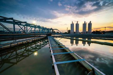 water treatment plant with sunset. water treatment plant, ecosystem, waste water, water recycle, water purification or environment industry concept
