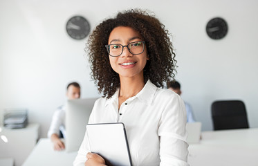 Black business consultant smiling for camera