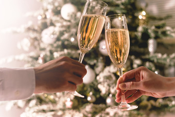 Celebration christmas and new year. Couple holding glasses of sparkling wine