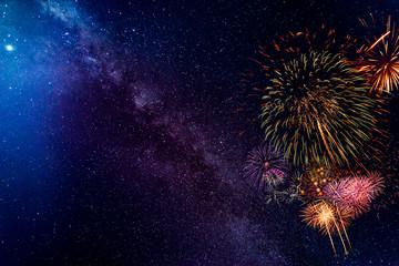 Fond de hotte en verre imprimé Univers Fireworks with blur milky way background
